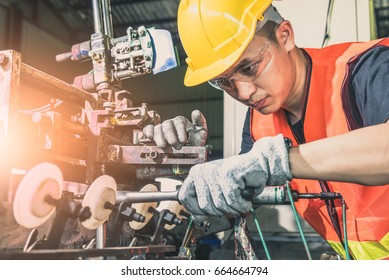 The abstract image of the technician repairing the machine in factory. the concept of industrial, machinery, experience and mechanism