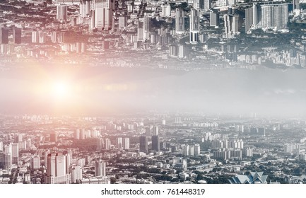 Abstract image of two modern urban worlds located upside down to each other on sky background. Wallpaper, backdrop with copyspace.