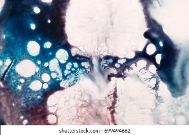 Abstract image of white splash on blue background. Watercolor spatter and drops of colors, similar to chemical reaction