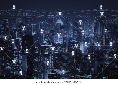 The abstract image of wireless network and wifi connection technology concept with bangkok city background at night in Thailand