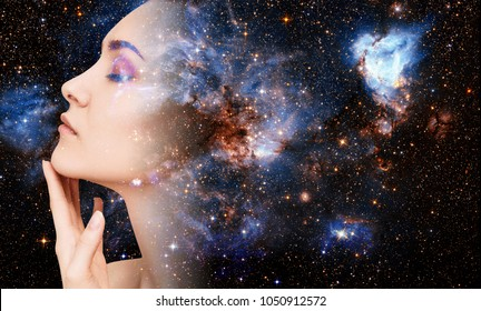 Abstract image of woman face and cosmic galaxy.