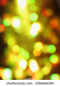 An abstract image of yellow, green and red lights