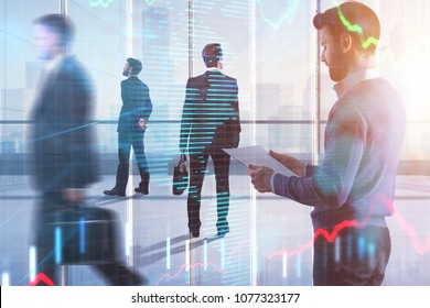 Abstract image of young businesspeople in modern office interior with forex chart, city view and sunlight. Meeting, teamwork, stock and economy concept. Double exposure