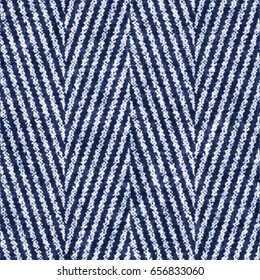 Abstract indigo dyed herringbone textured background. Seamless pattern.
