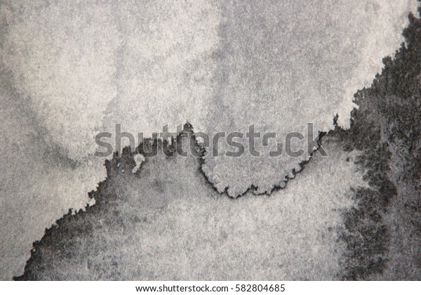 Abstract ink painting on grunge paper texture.