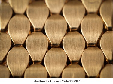 Abstract jewelry background. Gold metal ornament. Interlacing surface. Decoration for design. Selective focus. High quality photo