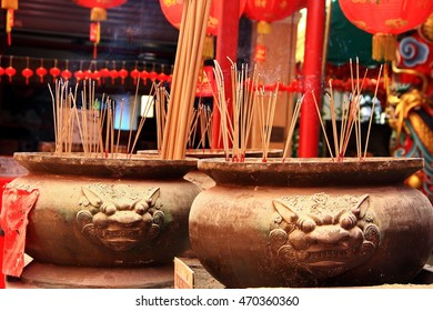 abstract joss stick in chinese pot