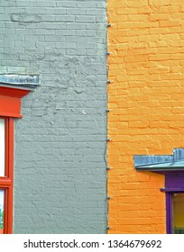Abstract juxtaposition of gray and orange buildings on Wall Street in Asheville, North Carolina