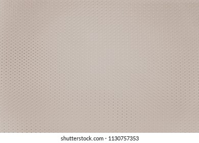 abstract knitted texture of fabric with a mesh pattern for a background or for wallpaper of pale cream color