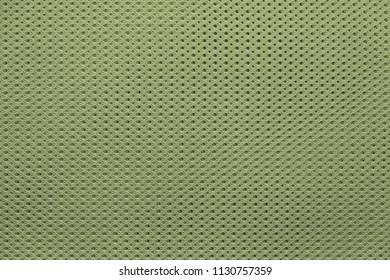 abstract knitted texture of fabric with a mesh pattern for a background or for wallpaper of green color