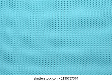 abstract knitted texture of fabric with a mesh pattern for a background or for wallpaper of azure color