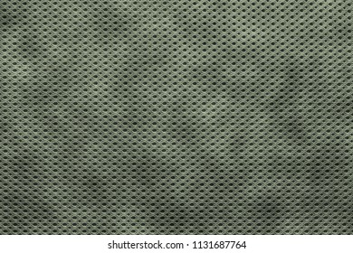 abstract knitted texture of fabric with a mesh pattern for a background or for wallpaper of dark green color