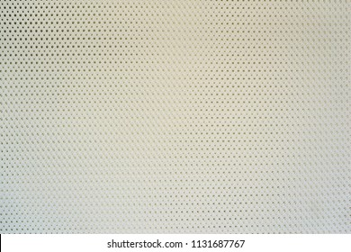 abstract knitted texture of fabric with a mesh pattern for a background or for wallpaper of pale white color