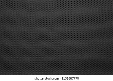 abstract knitted texture of fabric with a mesh pattern for a background or for wallpaper of dark black color