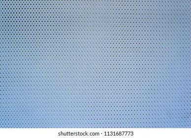 abstract knitted texture of fabric with a mesh pattern for a background or for wallpaper of pale blue color