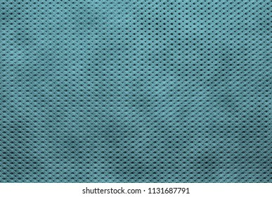 abstract knitted texture of fabric with a mesh pattern for a background or for wallpaper of blue color
