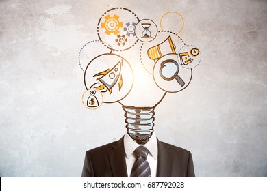 Abstract lamp and business icons headed businessman on concrete background. Solution concept
