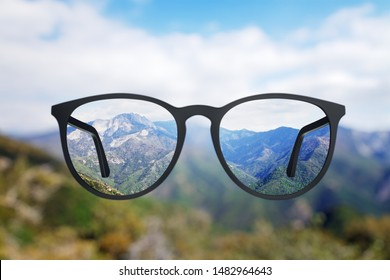 Abstract landscape view though eyeglasses. Blurry background. Vision concept