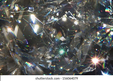 abstract, layered diamond closeup light refraction shapes and rays on black