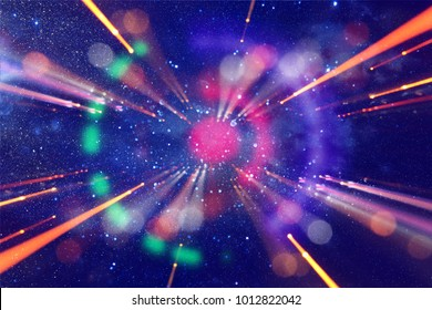 Abstract lens flare. concept image of space or time travel background over dark colors and bright lights