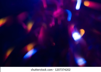 abstract lens flare on  background.  defocused bokeh lights. blur christmas wallpaper decor. festive glowing circles design.