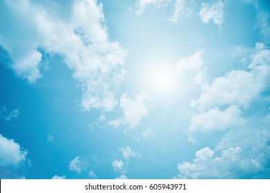 abstract light blue background, soft clouds and sky with sun rays