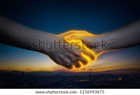 Abstract light effect image of business handshake , business cooperation success  concept .