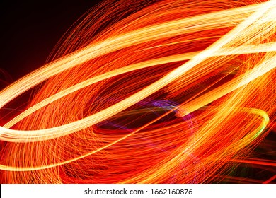 Abstract light pattern. Blurred neon lights. A dynamic backdrop for your design. Bright orange