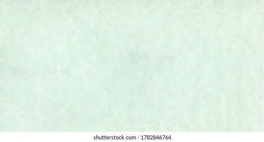Abstract light pistachio green background. Vintage pale green paper texture.