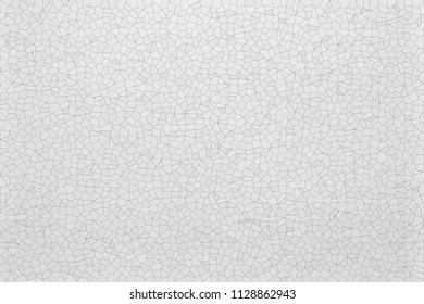 the abstract light textured background and wallpaper with imitation of paper or plastic with a mosaic pattern