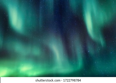 Abstract lines of aurora borealis in the night sky full of stars
