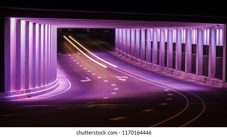Abstract lines and LED colored architecture . Night scene with an urban city look in a tunnel