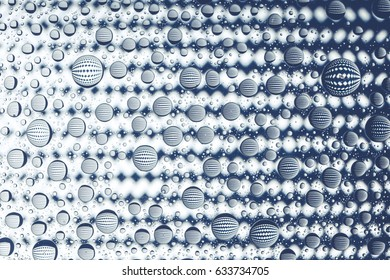 Abstract lines through drops of water on a glass, macro view