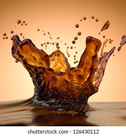 abstract liquid splash of brown hot coffee on orange background