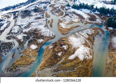 An abstract looking aerial of a river delta shot from a helicopter on the west coast of Vancouver Island, Canada.
