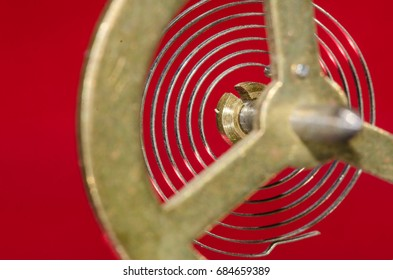 Abstract: Looking Through a Vintage Metallic Balance Wheel to Its Hairspring