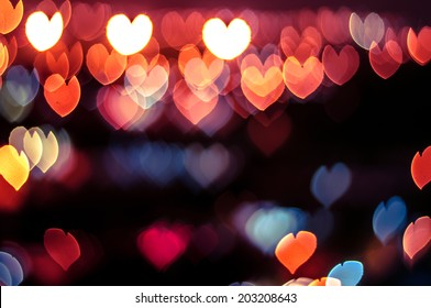 Abstract love or heart shape bokeh background of town in Malaysia