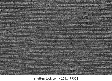 abstract macro texture of damp synthetic fabric for a background of dark gray color