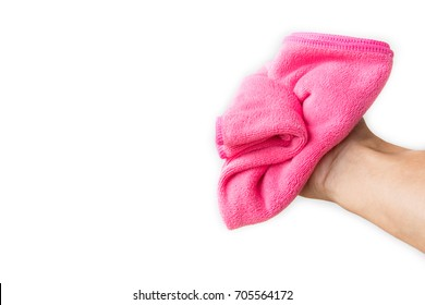 Abstract male hand holding pink microfiber cleaning cloth on white background.