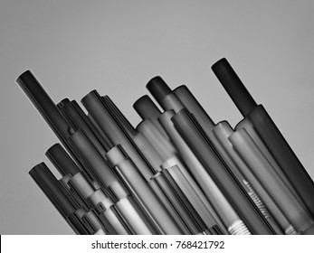 An Abstract Manipulated Photo of Drinking Straws on a Black and White Blurred Background