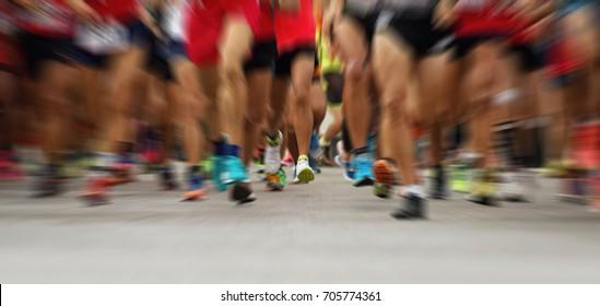 Abstract marathon running race, people feet on city road