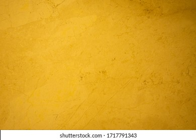 Abstract marble surface orange gold background golden yellow highlights
