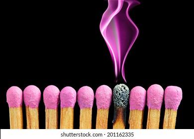 Abstract matchsticks with magenta smoke