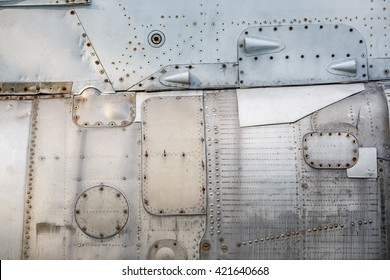 Abstract metal background. Old weathered silver metallic background. Vintage metal texture with rivets and bolts. Sheathing old plane. Old metal texture.