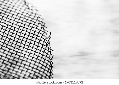 Abstract metal mesh fence closeup monochrome for banner with empty space for text