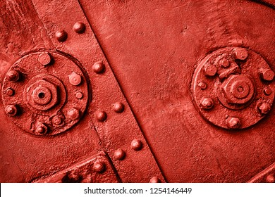 Abstract metal texture with bolts and rivets, copy space. Living Coral background. Color of the year 2019. Top view, flat lay