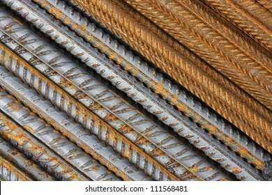Abstract metal texture pattern of rusty rebars. Diagonal.
