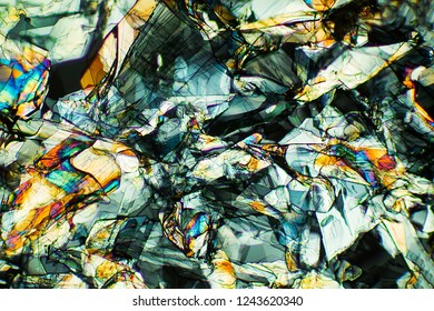 Abstract micrograph of amino acid crystals, methionine, photographed with a microscope at 40X, with a mass of shapes.