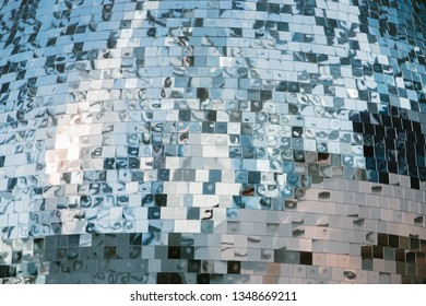 abstract mirror background reflection of a blurred silhouettes of people, a disco ball background