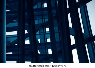 Abstract modern architecture background.  Close-up photo of robust steel framework of an office building exterior structure made of metal and glass.